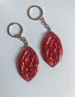 Vaginanøglering i rød med rødt glimmer