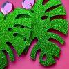 smukke grønne monstera øreringe i plexiglas