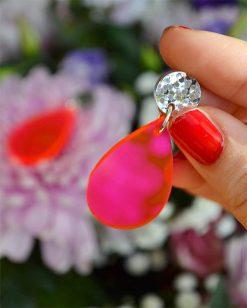 neonøreringe dråbeformede i pink med sølvglitter i toppen