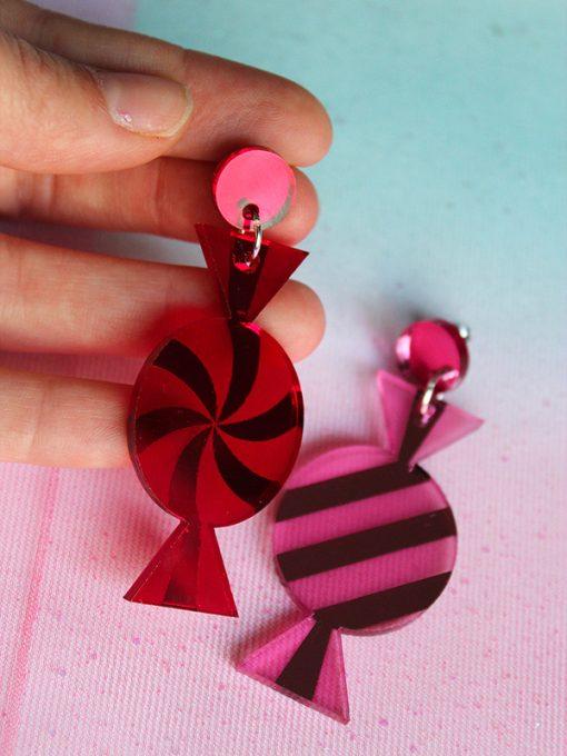 Saisall's lyserøde og røde slik karameller i plexiglas
