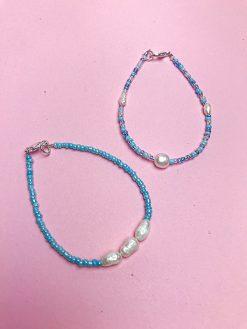 Ocean sæt fra Oliooes med blå perler og små runde ferskvandsperler