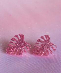 Mini monstera ørestik i plexiglas i pink glitter